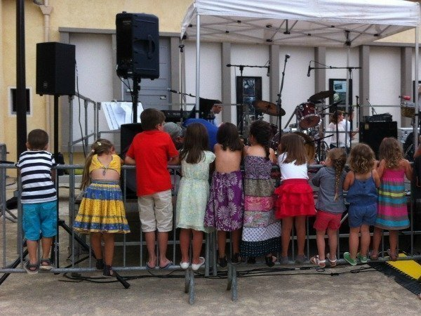 kids watching live band