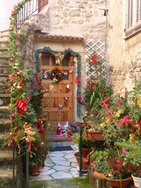 village doorway decorated for Christmas