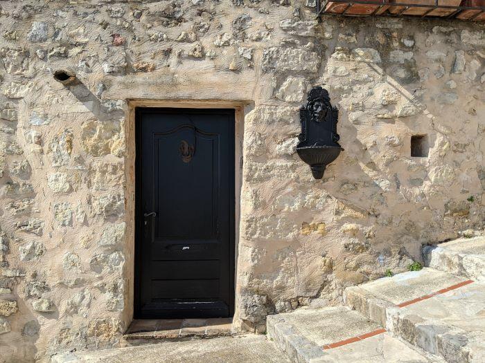 black door in stone wall