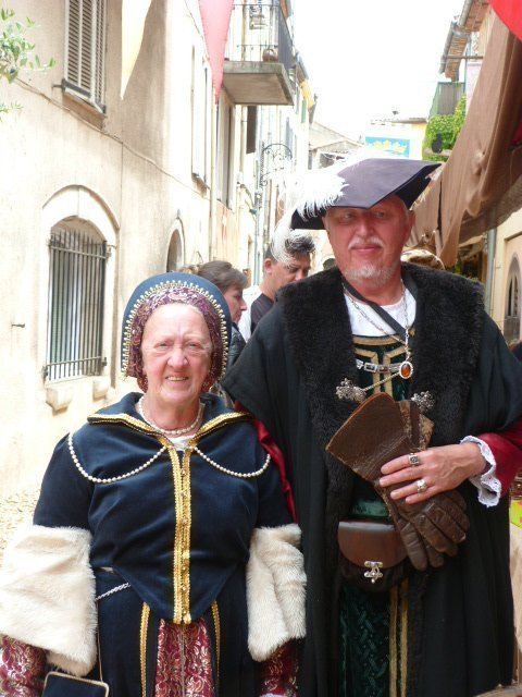 couple dressed in rennaissance clothes for June fêtes