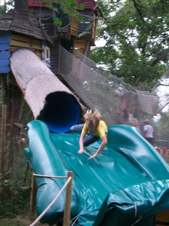 kid flying out of slide