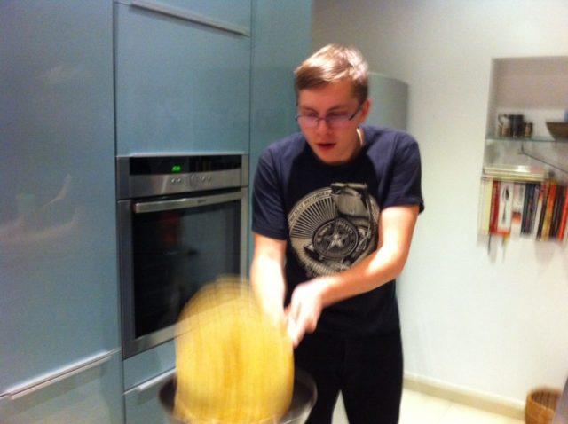 boy flipping a french crêpe