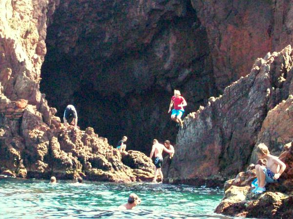 jumping off rocks at Pointe de lAiguille