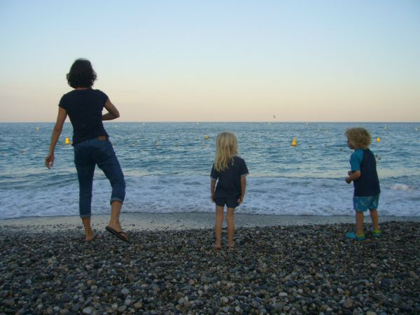 throwing stones on Villeneuve Loubet beach