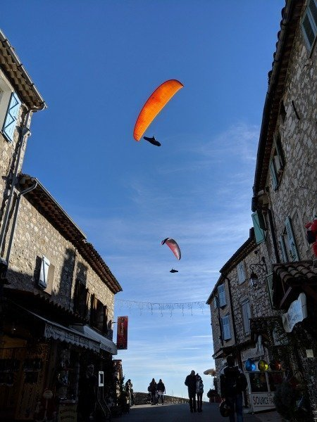 paragliders over Gourdon Alpes Maritimes France