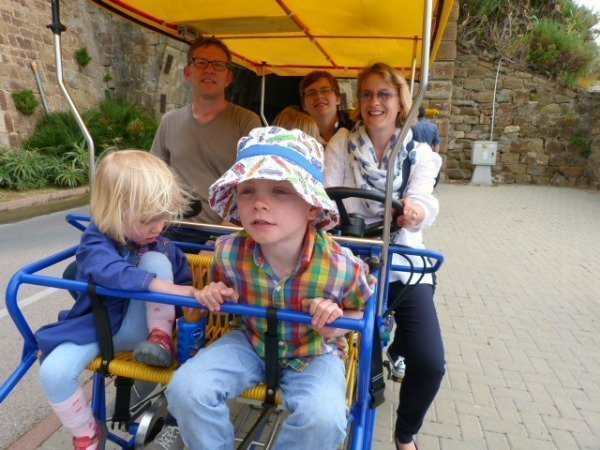 family on peddle cart