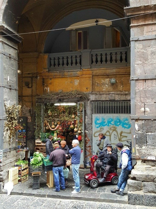 lads at shop in Naples