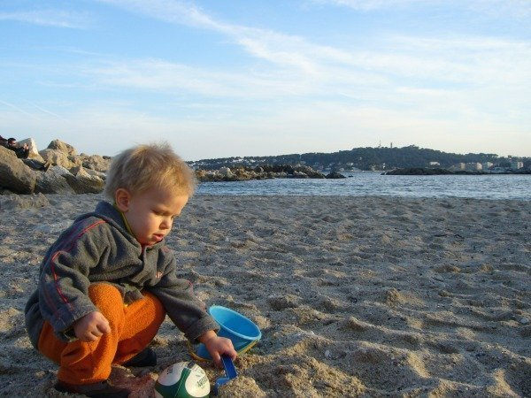 toddler on beach in winter
