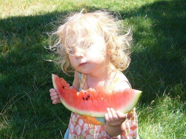 toddler with watermelon
