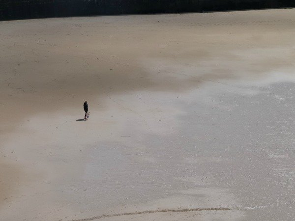 lone man on beach St Malo