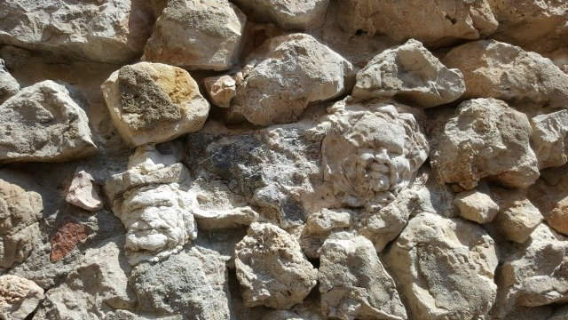 faces in wall Antibes