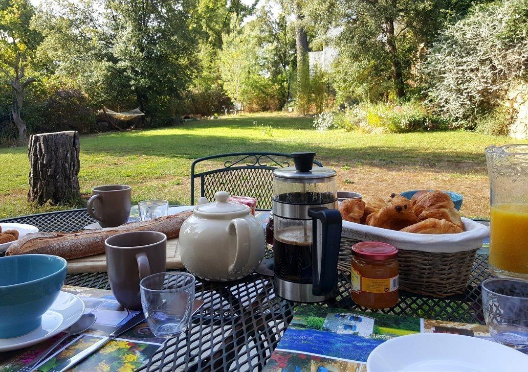 Breakfast on terrace looking over garden
