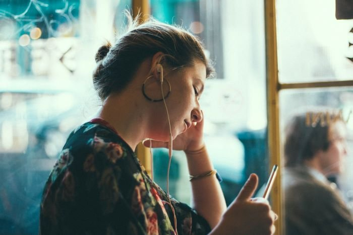 woman listening to music or podcast