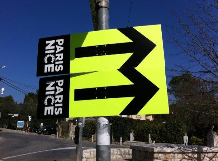 signs for Paris-Nice bike race
