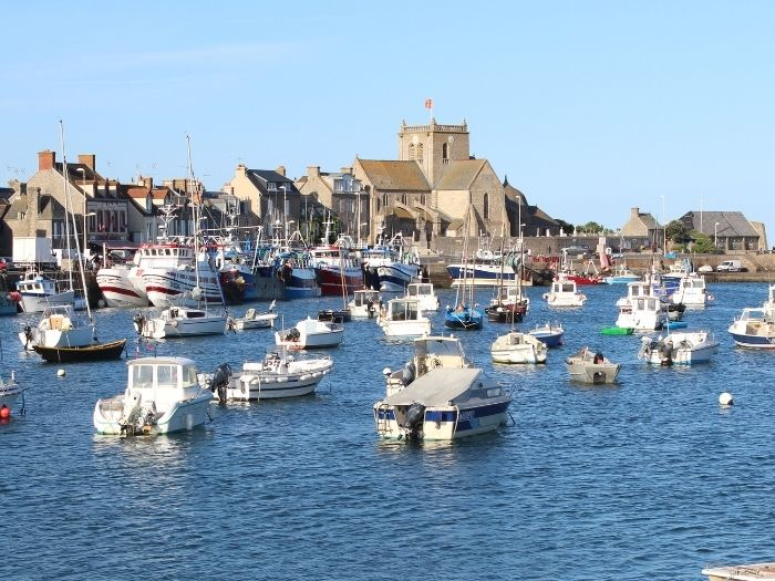 Barfleur harbour and church in Normandy