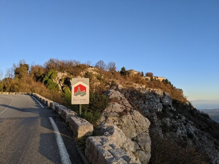 sign for beautiful village with Gordon in distance