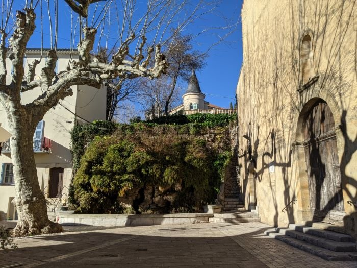 mossy fountain in charming village in the Var