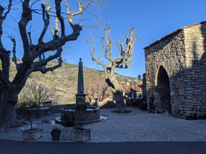 shady fountain and stone gateway